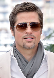 Brad pulls off this grey neck scarf effortlessly in Cannes.