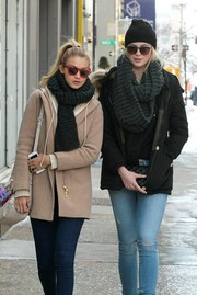 Gigi Hadid paired a black knit scarf with a beige coat for a stroll in New York City.
