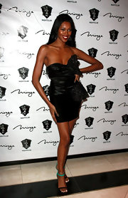 Jessica White topped off her black cocktail dress with strappy sandals complete with jade green detailing.
