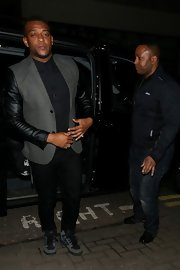 Oritse Williams mixed textures with a normal wool blazer with leather sleeves.