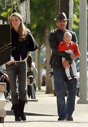 Gabriel looked ruggedly handsome in a black leather jacket as he goes for a stroll with his family.