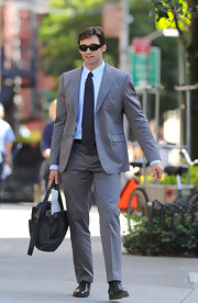 Hugh looks ultra chic in his suit with these shades.