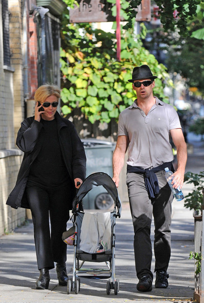 Jackman is out for a stroll with his family and his black fedora cap.