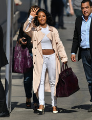 Underneath her coat, Jada Pinkett Smith was sporty in drawstring pants and a crop-top.