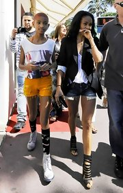 Willow Smith rocked a pair of bright yellow short shorts while out with her mom at the Cannes Film Festival.