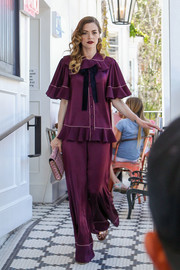 Jaime King worked the wide-leg trend with these plum-colored satin pants by Roksanda while visiting Au Fudge.