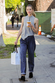 Jaime King sealed off her casual look with a pair of black booties.
