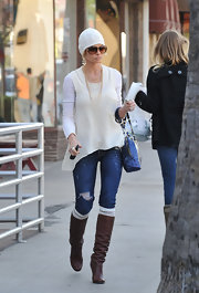 Jamie Pressly shows off a pair of chic leather boots while on a lunch date. She pairs them up with knee high socks, which has been seen on the feet of celebrities recently.