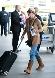 Jaime Pressly kept comfy in brown boots.