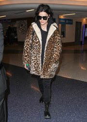 Underneath her coat, Jaimie Alexander kept it subdued in black skinny jeans and a matching top.
