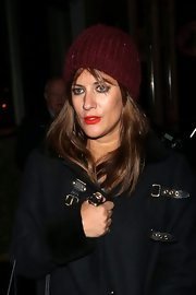 Caroline stayed cozy in a lovely burgundy beanie after an evening at the Groucho club.