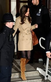 Pippa Middleton balanced a short trench with a handsome pair of camel knee-high boots as she visited her sister at King Edward Hospital.