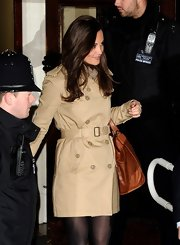 Pippa Middleton wore a classy belted trenchcoat as she visited Kate at King Edward Hospital.