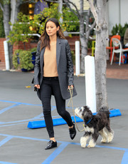 Jamie Chung donned a menswear-inspired getup, consisting of an oversized gray blazer and black skinny jeans, for a day out with her dog.