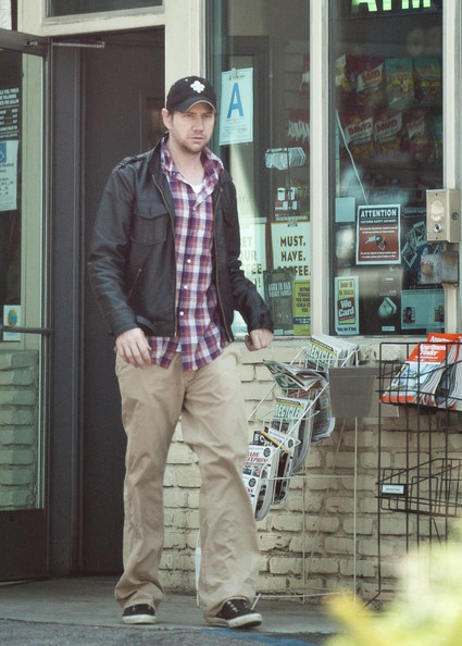 Jamie Kennedy wore a leather bomber jacket over his plaid button down in an effort to keep warm and stylish while running errands in Switzerland.