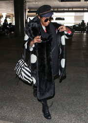 Janelle Monae worked her signature black-and-white style at LAX with this striped backpack and polka-dot coat combo.