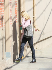 January Jones headed to 'Kimmel' wearing chunky-heeled lace-up boots.