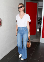 January Jones added a '70s vibe with a pair of flare jeans.