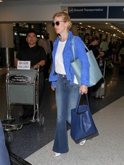 January Jones accessorized with a stylish blue leather tote.