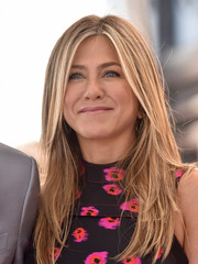 Jennifer Aniston attended Jason Bateman's Hollywood Walk of Fame ceremony wearing her signature layered hairstyle.