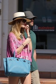 Rosie Huntington-Whitely wore a wide brimmed canvas hat while out shopping in St. Barts.