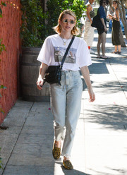 Emma Roberts teamed her shirt with a pair of faded boyfriend jeans.