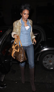 Former Destiny's Child member michelle Williams heads into Jay-Z concert after party carrying a rather large buckled tote.