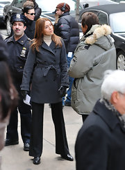 Saffron Burrows stayed warm and stylish with a gray trenchcoat.