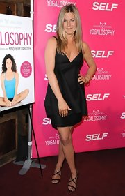 Jennifer Aniston showed off her yoga-toned body with this basic black dress.