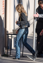 Jennifer Aniston accessorized with an elegant chain-strap bag during her visit to 'Kimmel.'
