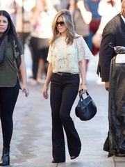 Jennifer Aniston effortlessly styled black wide leg pants on a visit to 'Jimmy Kimmel Live!'