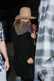 Jennifer Aniston looked a little shy wearing her Albertus Swanepoel hat low over her forehead while making her way through LAX.