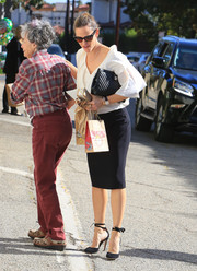 Jennifer Garner teamed a quilted Chanel clutch with a white ruffle blouse and a black pencil skirt for a day out in LA.