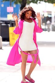 Jennifer kept comfy, cozy, and cute in between shots in this scorching-hot pink robe.