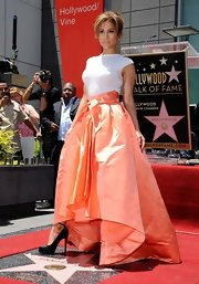 Jennifer Lopez complemented her voluminous coral skirt with a fitted white cap-sleeve top for a super-chic finish during her Hollywood Walk of Fame ceremony.