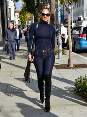 Jennifer Lopez wore a sheer blue turtleneck top for a sleek and sexy look.