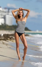 Jessica Hart struck a sensual pose in a black-and-white tankini during a Victoria's Secret photoshoot.