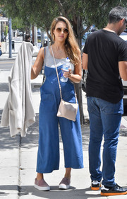 Jessica Alba kept her baby bump comfy in slouchy denim overalls while out and about in Los Angeles.