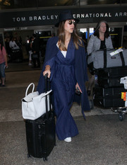 Jessica Alba topped off her outfit with a navy coat.