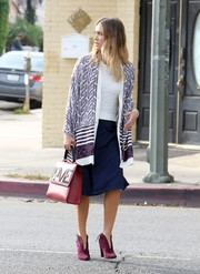 Jessica Alba looked charming in a patterned shawl layered over a white knit top while running errands.