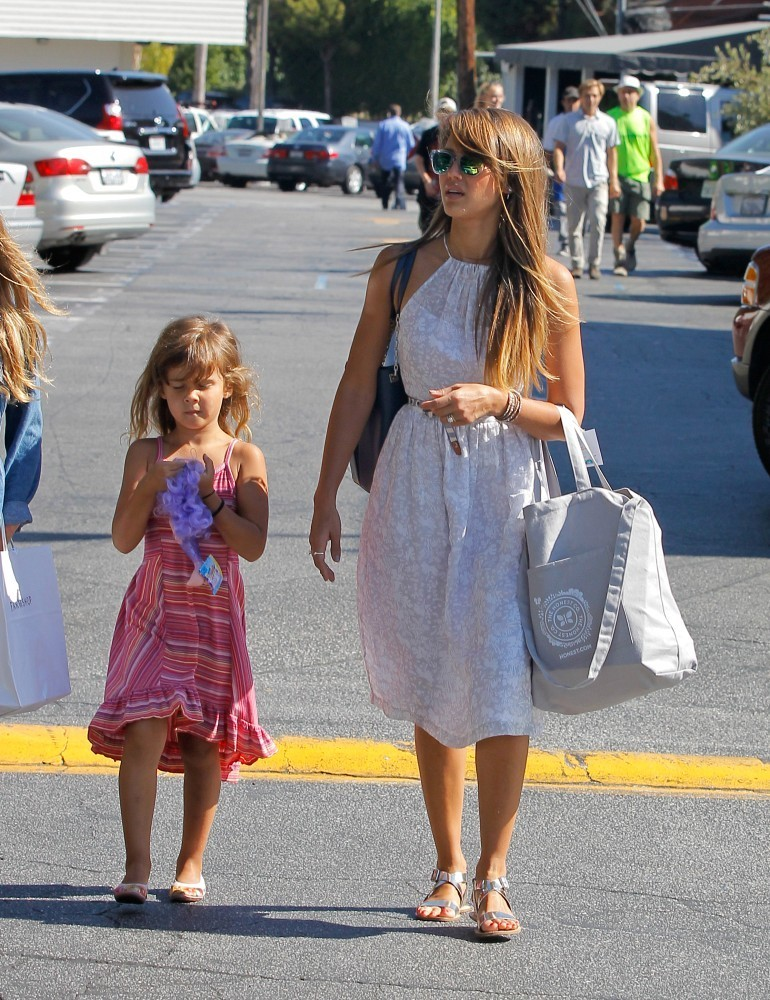 Jessica Alba and daughter Honor shop for flowers at the Trader Joe's market in Westwood, California.
