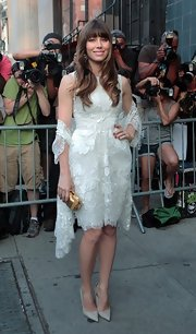 Jessica Biel added shine via a gold Elie Saab clutch.