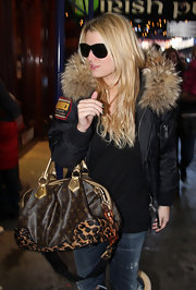 Blonde bombshell Jessica Simpson sports a straightened, center-parted hairstyle that shows off her chunky layers.