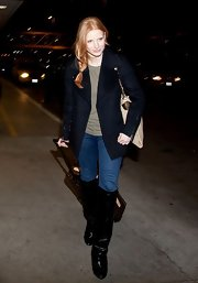 Jessica's faded skinny jeans channeled a cool-girl edge with sleek leather boots up-to-there.