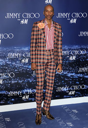 RuPaul showed off his fashion flair in a checkered suit and leopard print boots while hitting the Jimmy Choo for H&M event.