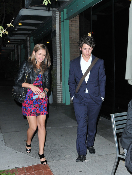 Nick looked like the perfect gentleman in a dark blue suit while on a double date with his older brother.