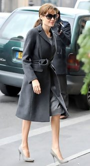 Angelina Jolie looked the part of the star in a tailored wool trench, classic pumps and large black sunglasses.
