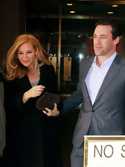 Jennifer Westfeldt was spotted at the NBC Studios sporting a brown suede clutch and black coat combo.