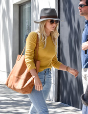 Julianne Hough tried to keep a low profile with a gray fedora and a pair of shades while out and about in LA.