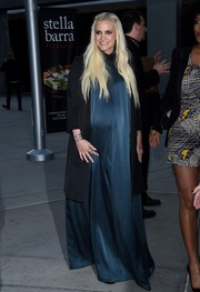 Ashlee Simpson covered up her baby bump in a blue silk maxi dress for the LA screening of 'Just Before I Go.'
